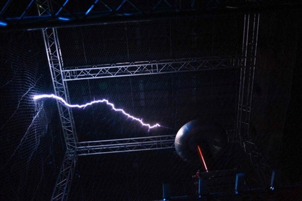 Nobody Beats the Drum perform with a Tesla Coil.